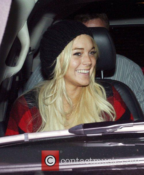 Lindsay Lohan enjoys a night out wearing a...