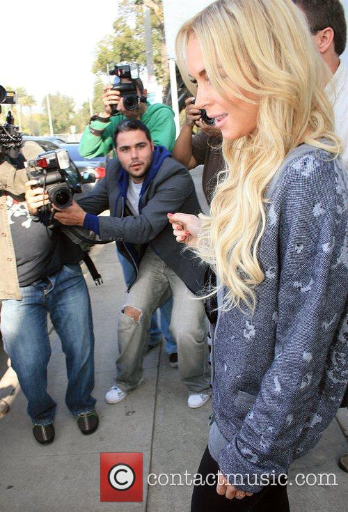 Lindsay Lohan goes into an office on Formosa Avenue Los...