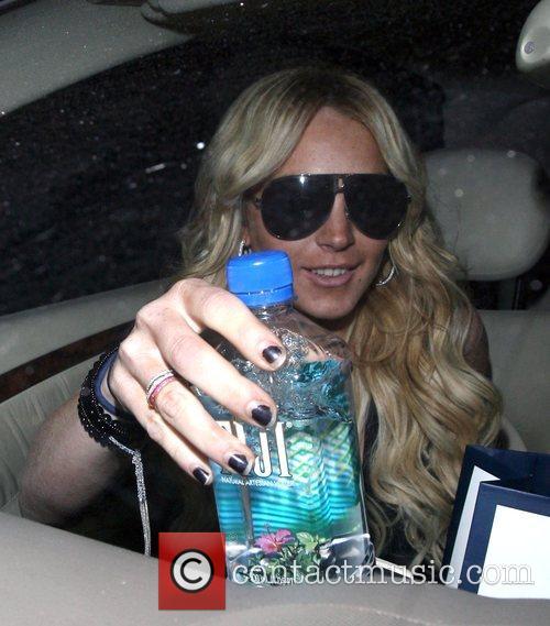 Lindsay Lohan leaving a hair salon sporting a...