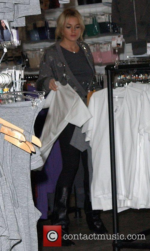 Lindsay Lohan shops at American Apparel Los Angeles,...