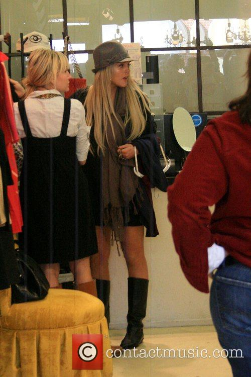 Lindsay Lohan shopping in Memory Lane clothing store...