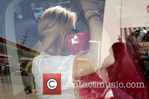 Lindsay Lohan goes shopping at Diavolina boutique on...
