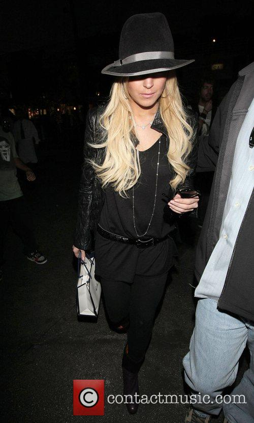 Linday Lohan carrying a Ron Herman shopping bag...