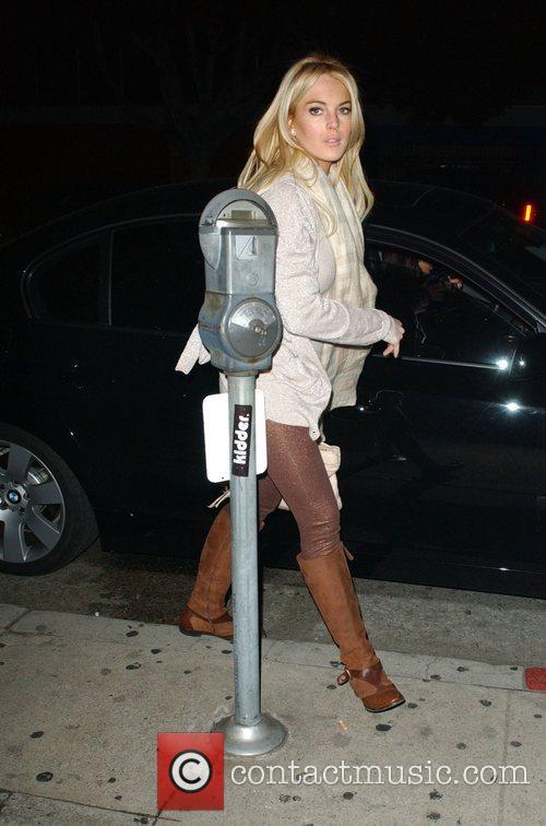 Lindsay Lohan arriving at a sushi restaurant in...