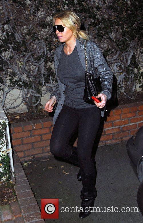 Lindsay Lohan visits a divorce lawyer's office on...