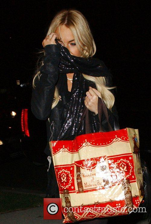 Lindsay Lohan hides her face from the cameras...