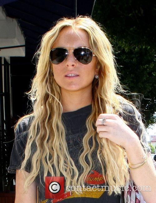 Lindsay Lohan goes shopping at American Rag in...
