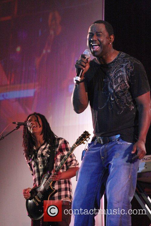 Brian McKnight, right, with son, Niko McKnight performing...