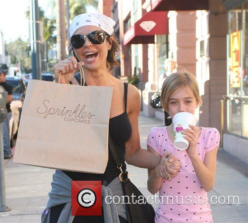Lisa Rinna walking though Beverly Hills after shopping...