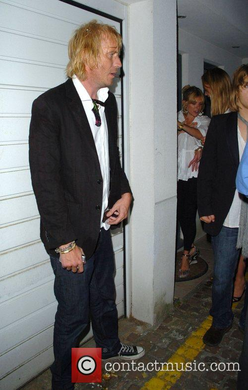 Rhys Ifans and Sienna Miller, leaving the Lonsdale...