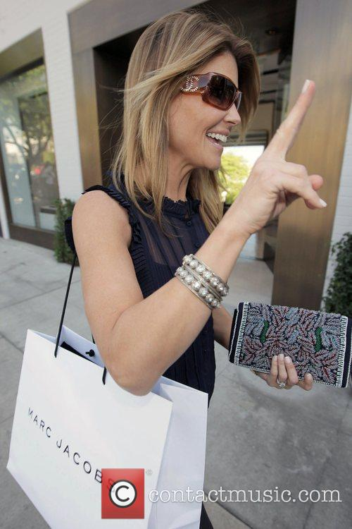 Lori Loughlin carrying a Marc Jacobs shopping while...