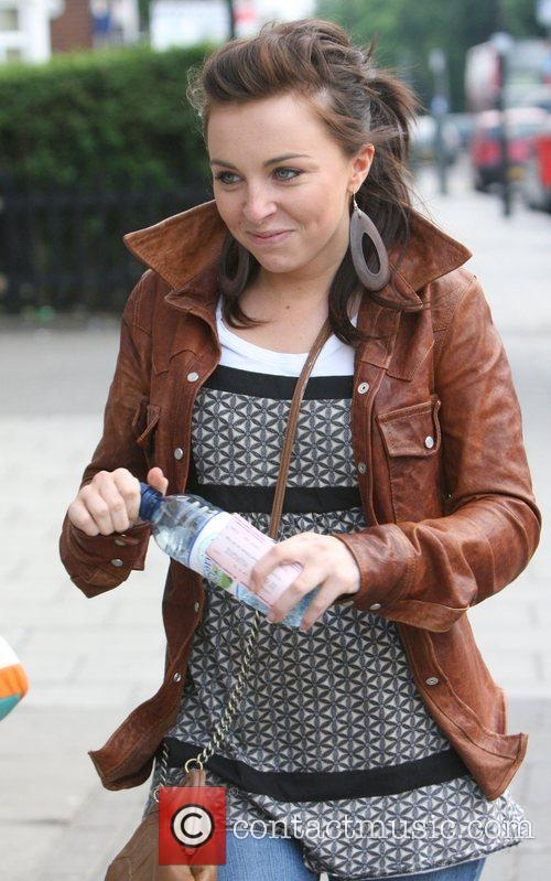 Louisa Lytton wearing Ugg boots and a brown...