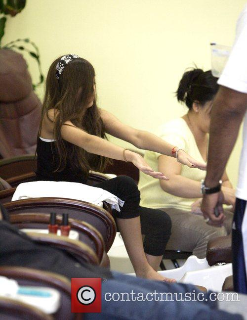 Gets a manicure and pedicure at a Beverly...