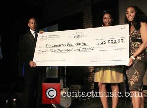 Chris Ludacris Bridges and Felicia Fletcher and Michele...
