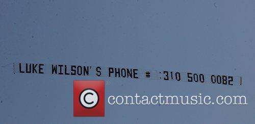 Luke Wilson's phone number being flown across the...