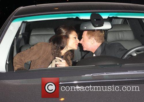Elliot Mintz leaving Madeo restaurant with a female...
