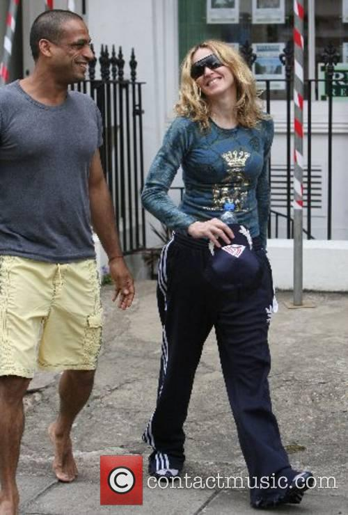 Is all smiles as she leaves the gym...