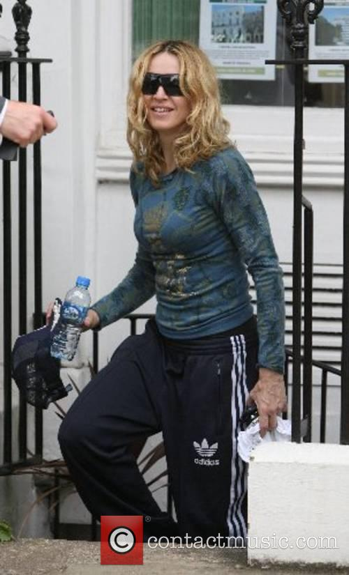 Madonna is all smiles as she leaves the...