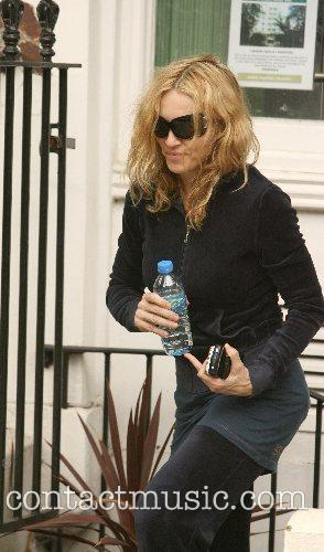 Madonna leaving the gym wearing a dark blue...