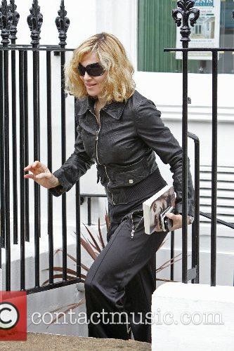 Madonna leaves the gym with a copy of...