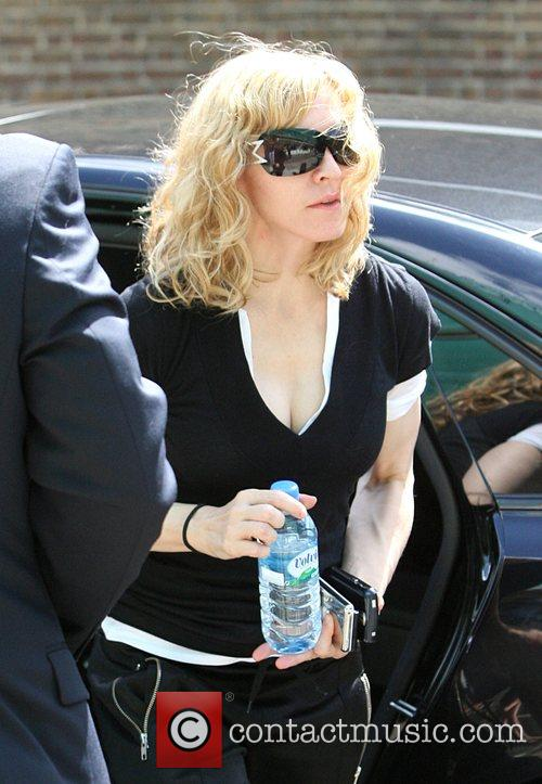 Madonna  arriving at the gym carrying 3...