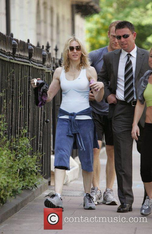 Madonna leaves her gym looking very muscular London,...