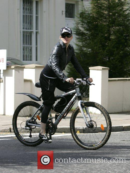 Cycles home from the gym, accompanied by her...