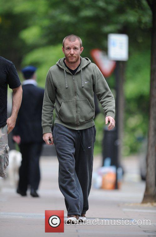 Guy Ritchie leaving the gym next door to...