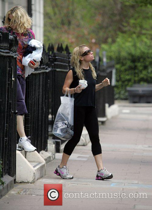 Madonna and her personal trainer leaving the gym...