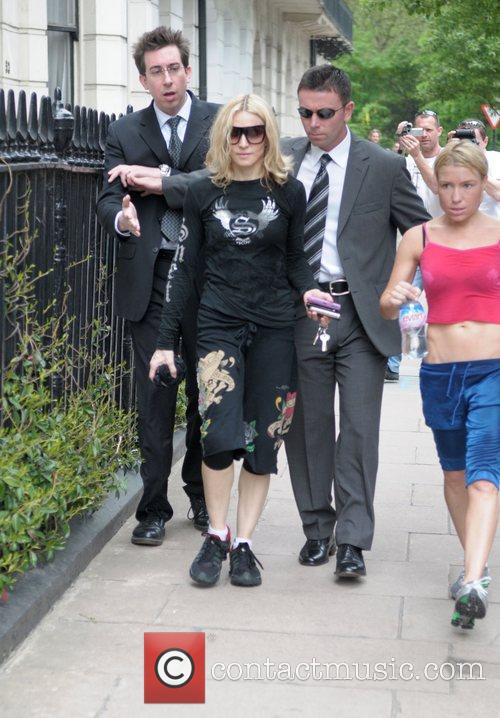 Madonna leaving her gym with her personal trainer....