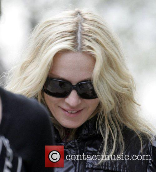 Madonna leaving her house with her assistant to...