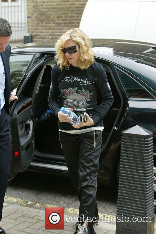 Madonna arriving at the gym wearing an Ed...