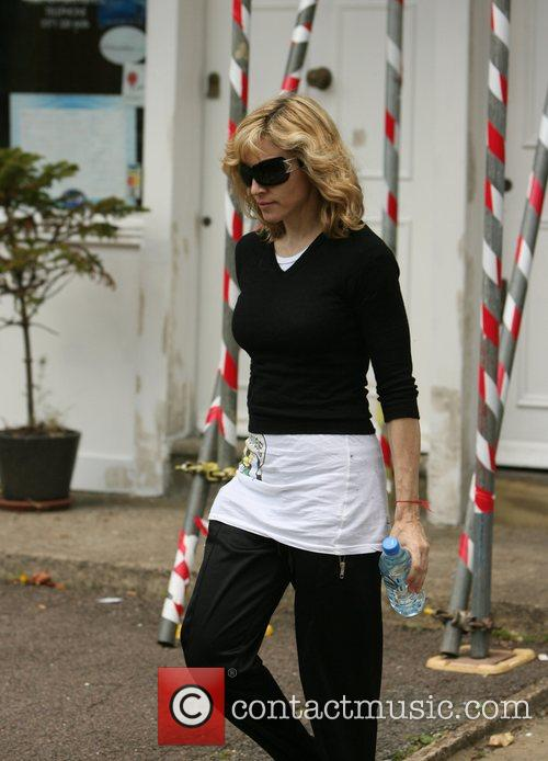 Madonna leaving the gym, dressed in black and...