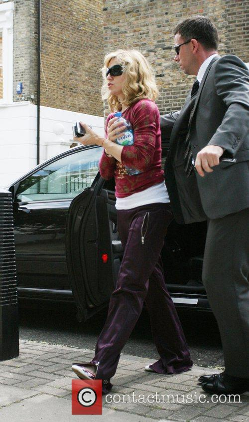 Madonna arrives at the gym and appears to...