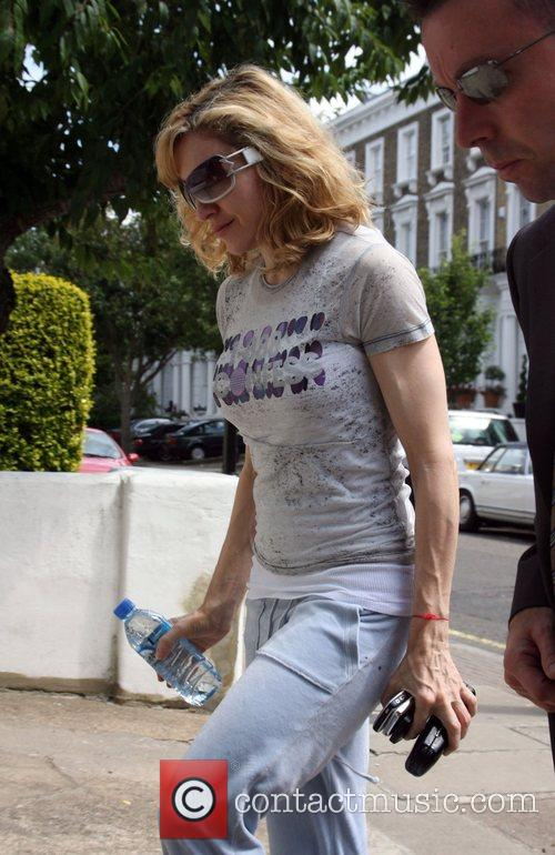Madonna arriving at her gym wearing one of...