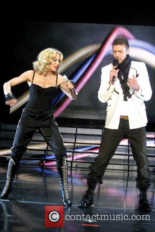 Madonna and Justin Timberlake performing at a thank...