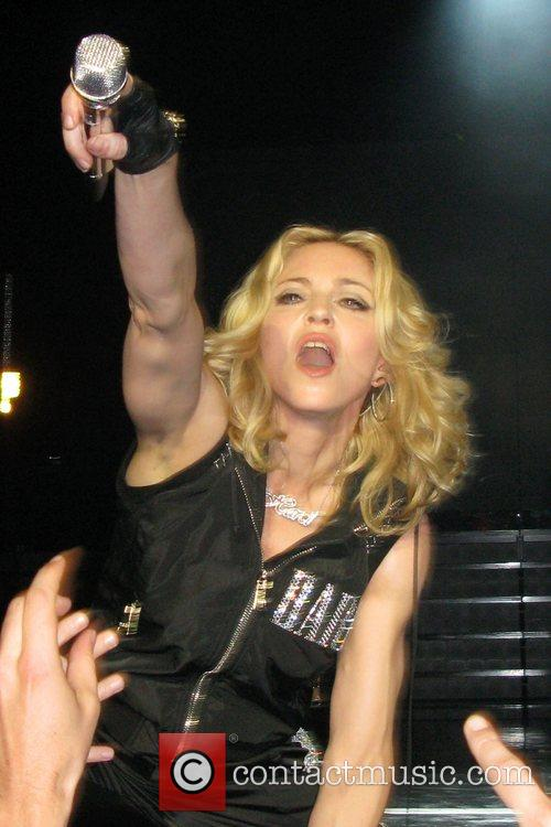 Madonna performing at a thank you show for...