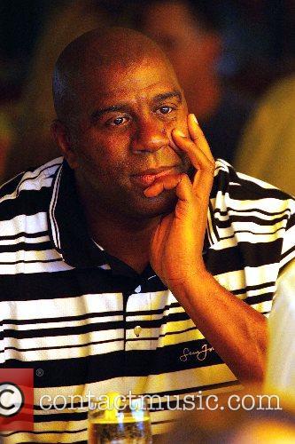 Magic Johnson (aka Earvin Johnson, Jr.) out for...