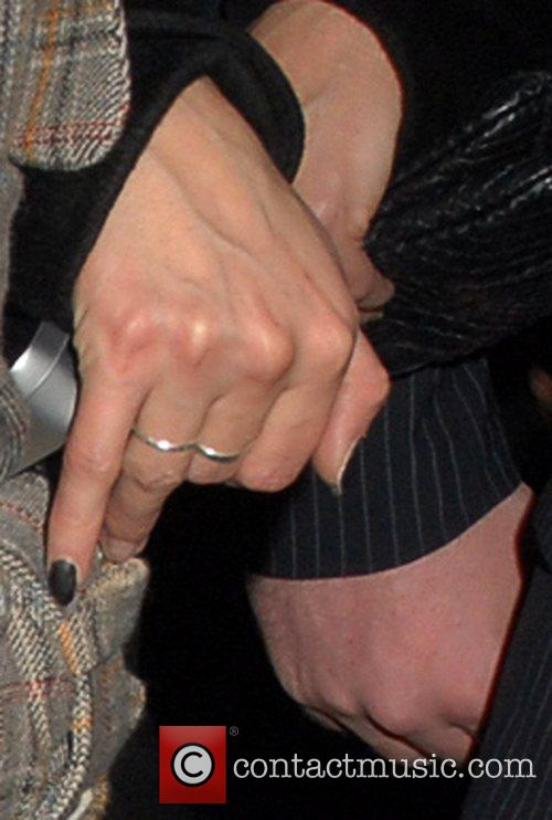 Sarah Harding wearing a ring on her engagement...