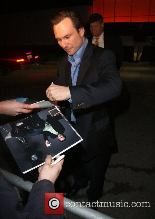 Signs autographs for fans after leaving an Oscar...