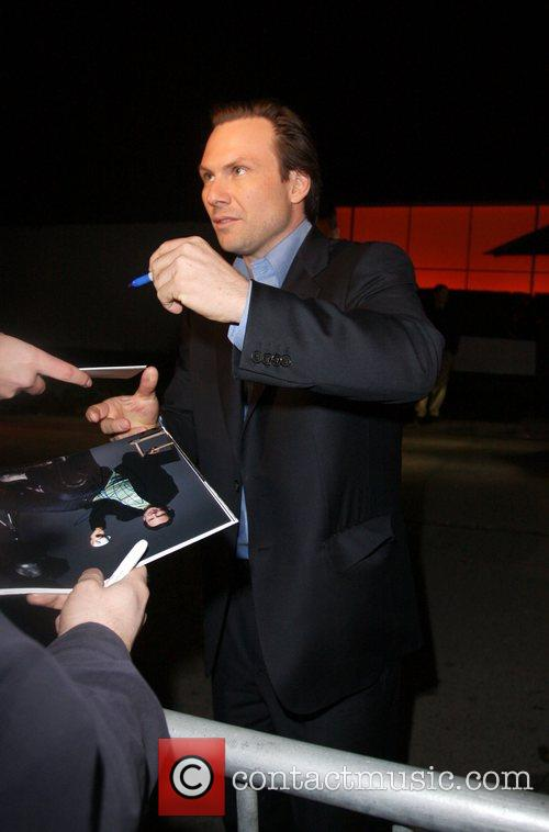 Christian Slater signs autographs for fans after leaving...