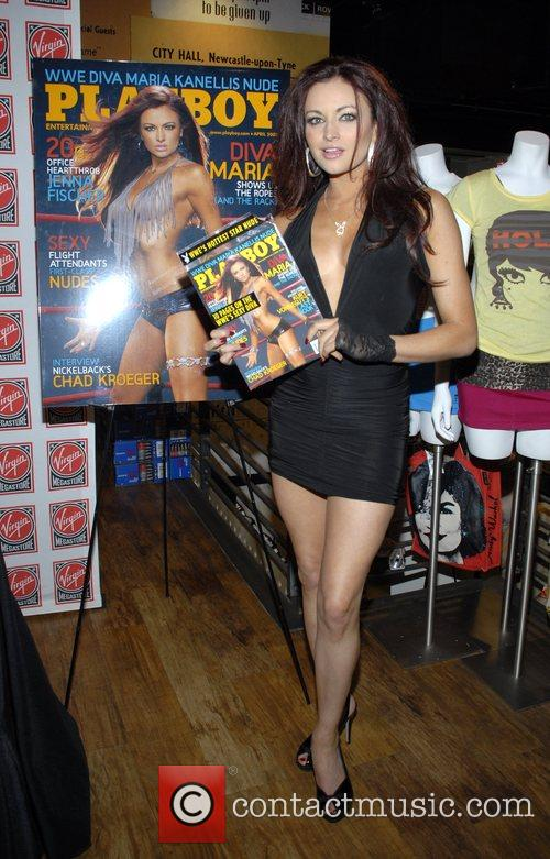 WWE diva and model signs copies of her...
