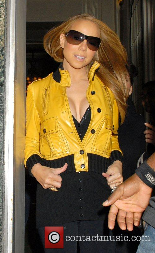 Mariah Carey and leaving Claridges hotel. 5