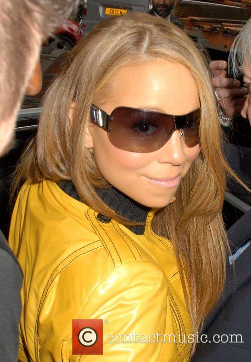 Mariah Carey and leaving Claridges hotel. 4