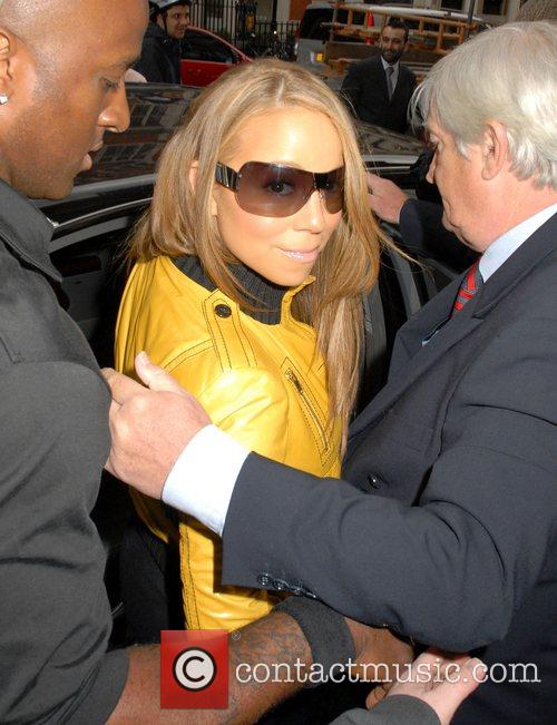 Mariah Carey and leaving Claridges hotel. 6