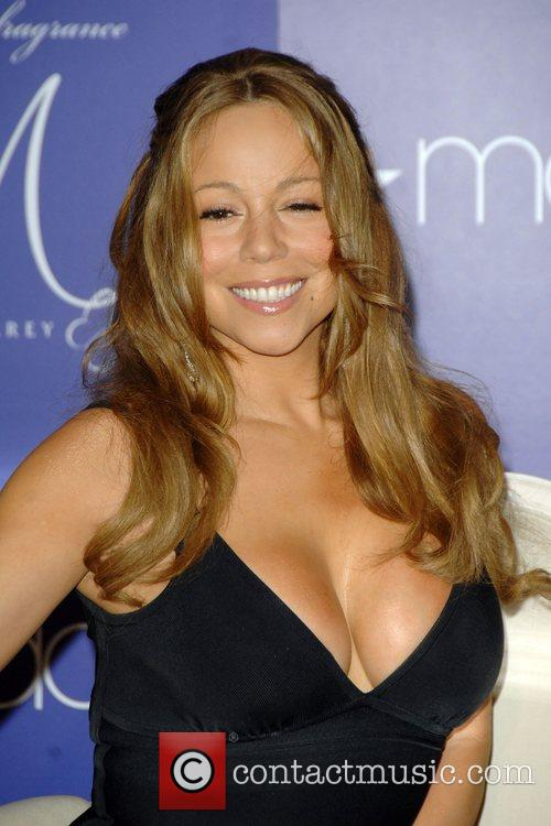 Launches her debut fragrance 'M by Mariah Carey'...