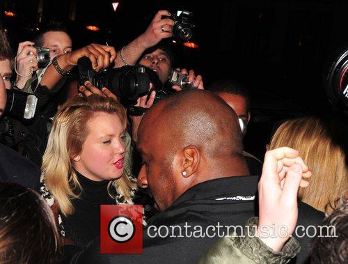 A huge crowd greets Mariah Carey as she...