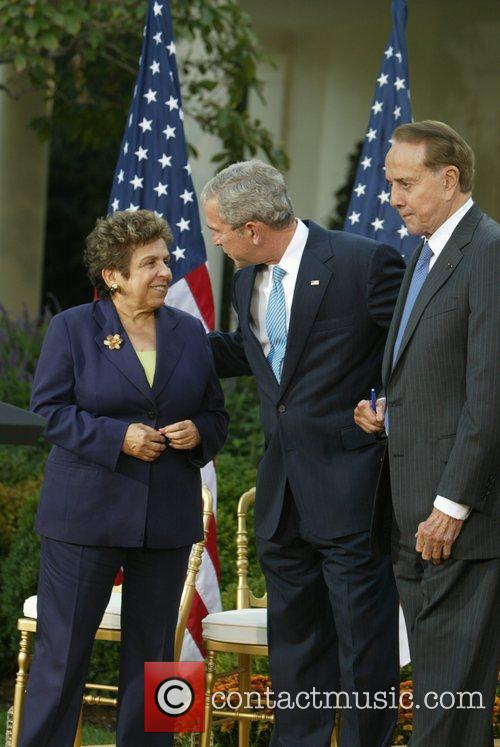 Former Senator Robert Dole and President George W....