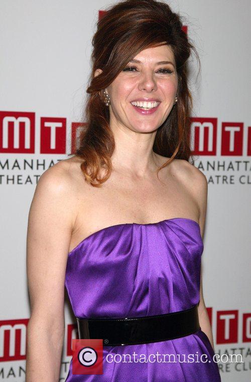 Marisa Tomei wearing a purple Alexander McQueen dress...