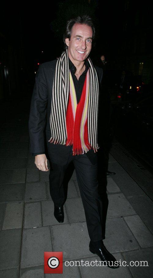 Tim Jefferies walking the streets of Mayfair wearing...